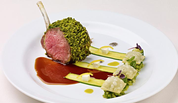 Pistachio-Crusted Lamb Chop with Minted Zucchini, Pistachio Pistou, Feta Cheese